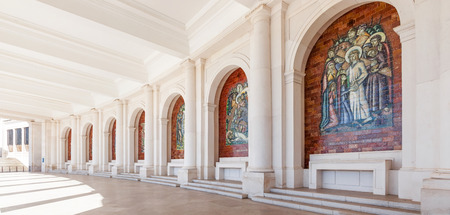 our: Sanctuary of Fatima, Portugal. Panels decorating the colonnade on both sides of the Basilica of Our Lady of the Rosary.  Major Marian Shrine and pilgrimage location for Catholics Stock Photo