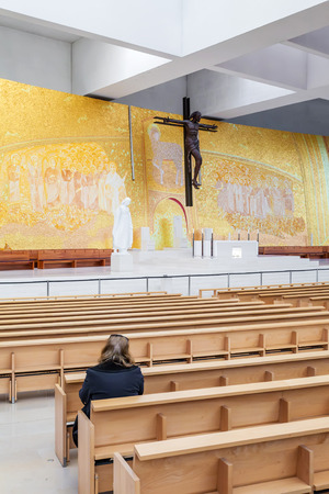 sanctuary: Sanctuary of Fatima, Portugal. Faithful praying inside the modern Minor Basilica of Most Holy Trinity. Fatima is one of the most important pilgrimage locations for the Catholics