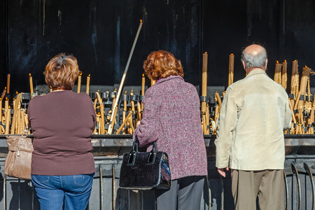vows: Sanctuary of Fatima, Portugal. Pilgrims burning votive candles as fulfillment of vows made to Our Lady. Fatima is one of the most important pilgrimage locations for Catholics