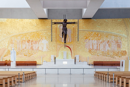 alexandros: Sanctuary of Fatima, Portugal. Basilica of Most Holy Trinity altar. Crucifix by Catherine Greene and Back Wall by Marko Ivan Rupnik. Fatima is a major Marian Shrine pilgrimage site Editorial