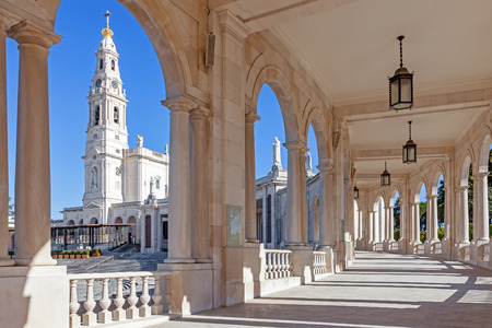 our: Sanctuary of Fatima, Portugal. Basilica of Our Lady of the Rosary seen from and through the colonnade. One of the most important Marian Shrines and pilgrimage locations for Catholics