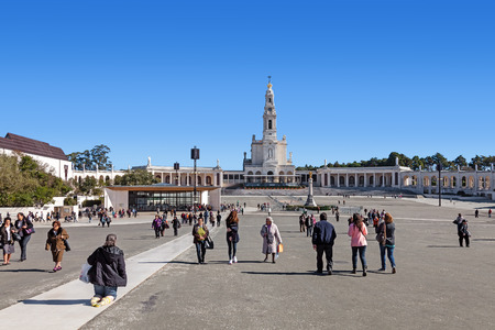 fulfilling: Sanctuary of Fatima, Portugal, March 07, 2015 - Devout walking the Penitential Path on knees and pilgrims. Our Lady of Rosary Basilica and Chapel of Apparitions at the back. Editorial