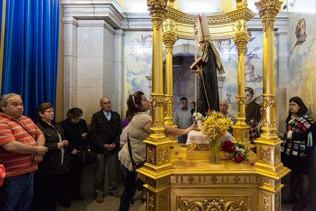 fanatics: S. Bento da Porta Aberta Portugal. April 06 2015: Pilgrims in need making requests to St Benedict statue. Pope Francis raised the sanctuary church to Basilica in the 400th anniversary March 21st Editorial