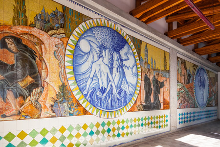 adam eve: S. Bento da Porta Aberta, Portugal. April 06, 2015: Adam, Eve and Eden. Crypt tiles with Bible and St Benedict life. Pope Francis raised the Sanctuary to Basilica in the 400th anniversary, March 21st