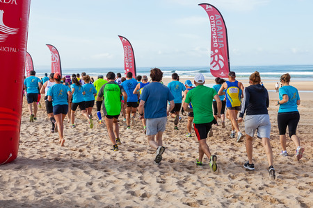 start line: Costa da Caparica Portugal. April 19 2015: Meia Maratona das Areias  Half Marathon of the Sands  start line. Running competitions on the sand are an athletic event growing in popularity