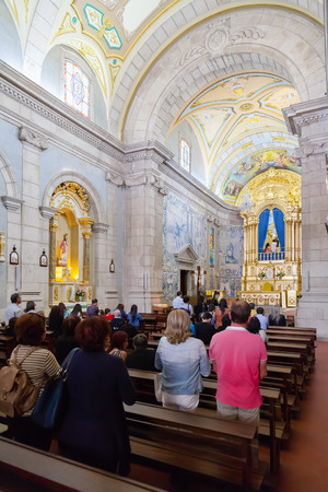 promoted: Terras de Bouro Portugal. April 06 2015: Faithful praying in the interior of the Sanctuary of Sao Bento da Porta Aberta. Pope Francis promoted it to Basilica in the 400th anniversary in March 21st