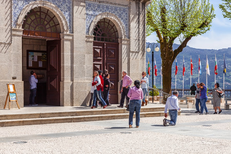 fundamentalism: Sao Bento da Porta Aberta Portugal. April 06 2015: Devout walks the Penitential Path on knees around the Church. Pope Francis promoted the Sanctuary to Basilica in the 400th anniversary March 21st