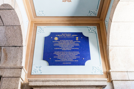 exhibiting: Sao Bento da Porta Aberta Portugal. April 06 2015: The commemorative plaque exhibiting the promotion of the Sanctuary church to Basilica by Pope Francis on its 400th anniversary in March 21st Editorial