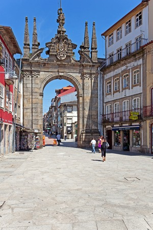 18th century: Braga, Portugal - July 27, 2015: Arco da Porta Nova Gate. A Baroque Monumental Arch built in the 18th century to be the main city gate and a landmark of the city.