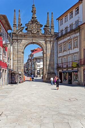 main gate: Braga, Portugal - July 27, 2015: Arco da Porta Nova Gate. A Baroque Monumental Arch built in the 18th century to be the main city gate and a landmark of the city.