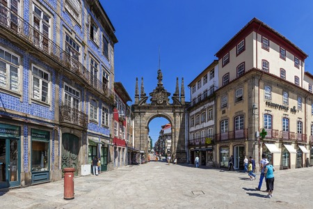 18th: Braga, Portugal - July 27, 2015: Arco da Porta Nova Gate. A Baroque Monumental Arch built in the 18th century to be the main city gate and a landmark of the city.