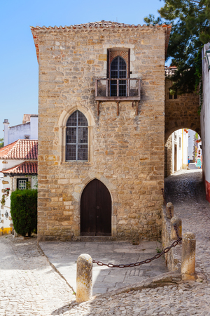 sephardi: Obidos, Portugal - August, 2015: Medieval Sephardic Synagogue dated from the 14th or 15th century. Obidos is a medieval town inside walls, and very popular among tourists.
