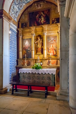 altarpiece: Obidos, Portugal - August, 2015: Saint Catherine Chapel with an altarpiece inside the medieval Santa Maria Church. Obidos is a medieval town inside walls, and very popular among tourists.