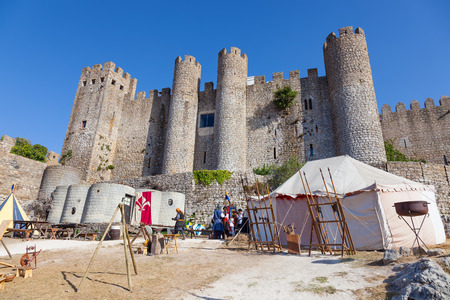 re enactment: Obidos, Portugal - August 09, 2015: Obidos Castle during the Medieval Fair reenactment. Obidos is a medieval town inside walls, and very popular among tourists.