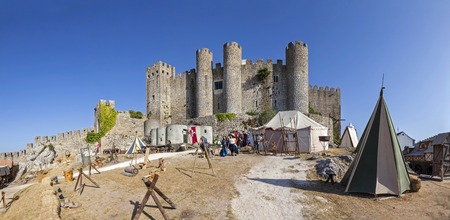 reenactment re enactment: Obidos, Portugal - August 09, 2015: Obidos Castle during the Medieval Fair reenactment. Obidos is a medieval town inside walls, and very popular among tourists.