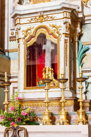 baroque architecture: Obidos, Portugal - August, 2015: The stone cross placed in the altar is the relic of the Sanctuary of Senhor do Jesus da Pedra. Baroque architecture.