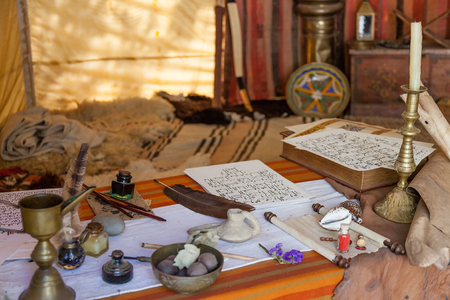 scribe: Obidos, Portugal - August 09, 2015: Medieval Moorish scribe tent reenactment in the very popular Medieval Market. Obidos is a medieval town inside walls, and very popular among tourists.