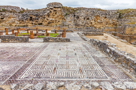 Roman ruins of Conimbriga. View of the House of the Swastika, the mosaics and Defensive Wall. Conimbriga, in Portugal, is one of the best preserved Roman cities on the west of the empire.