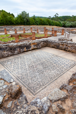swastika: Room on the Domus of the Swastika, decorated with mosaics with a view on the peristyle, garden and pond. Conimbriga in Portugal, is one of the best preserved Roman cities on the west of the empire.