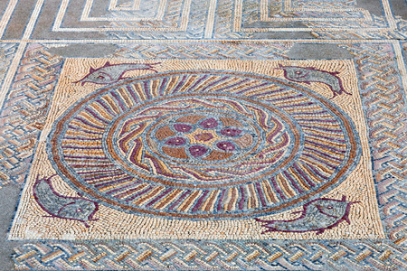 polychromatic: Close-up of a decorative Roman tessera mosaic pavement in the peristyle of the House of Fountains. Conimbriga in Portugal, is one of the best preserved Roman cities on the west of the empire.