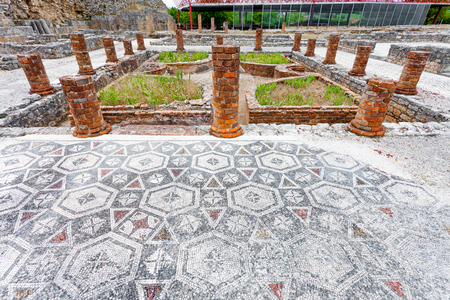 swastika: View of the inner pond and garden with the Peristyle columns and mosaic floor, on the Swastika Domus. Conimbriga in Portugal, is one of the best preserved Roman cities on the west of the empire.