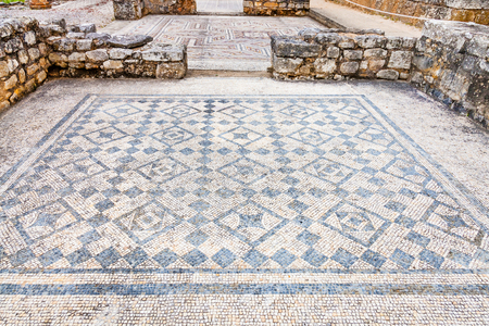 swastika: Room decorated with monochrome Roman mosaic pavement made with tesseras, in the House of the Swastika. Conimbriga in Portugal, is one of the best preserved Roman cities on the west of the empire. Stock Photo