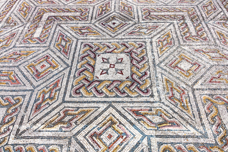 swastika: Close-up on a complex Roman tessera mosaic pavement center. Swastika Domus. Conimbriga in Portugal, is one of the best preserved Roman cities on the west of the empire.