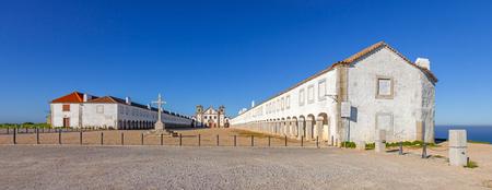 lodgings: Baroque Sanctuary of Nossa Senhora do Cabo in Espichel Cape. View of the Church, the Pilgrim lodgings and stone cross. Sesimbra, Portugal Stock Photo