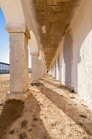 lodgings: The arcades of the pilgrim lodgings in the Baroque Sanctuary of Nossa Senhora do Cabo, aka Nossa Senhora da Pedra Mua in Espichel Cape. Sesimbra, Portugal