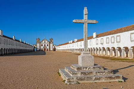 senhora: Stone Cross in front of the Church and Pilgrim lodgings of the Sanctuary of Nossa Senhora do Cabo. Espichel Cape, Sesimbra, Portugal