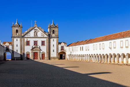 religious building: Baroque Sanctuary of Nossa Senhora do Cabo in Espichel Cape. View of the Church, and the Pilgrim lodgings. Sesimbra, Portugal Stock Photo