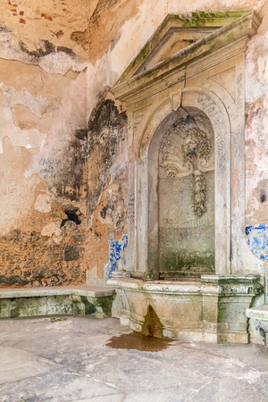 senhora: Interior of the vandalized Casa da Agua Water House, an 18th century fountain and reservoir built for the pilgrims of the Nossa Senhora do Cabo Sanctuary. Espichel Cape, Sesimbra, Portugal. Stock Photo
