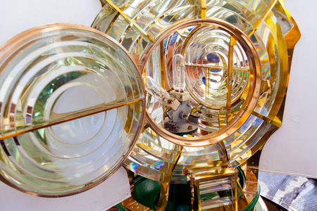 reflector: Close-up on a Fresnel optic system and light bulbs of a lighthouse. Espichel Cape Lighthouse in Sesimbra, Portugal. Stock Photo