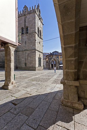 senhora: Guimaraes, Portugal - October, 2015: Nossa Senhora da Oliveira Church and Salado Monument in Oliveira Square seen through the old Town Hall arcade. Editorial