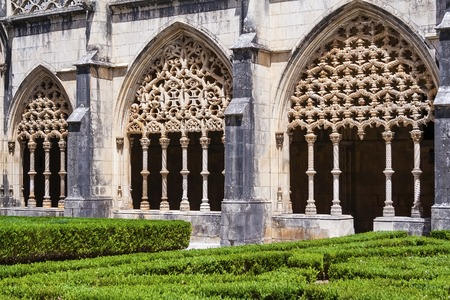 stonework: Batalha, Portugal - July, 2015: Intricate stonework on the Royal Cloister of the Batalha Abbey. Masterpiece of the Gothic and Manueline art.