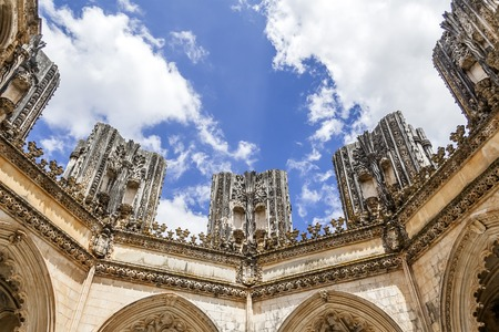 monastery: Batalha, Portugal - July, 2015: Looking up, inside the Unfinished Chapels Capelas Imperfeitas of the Batalha Monastery. A masterpiece of the Gothic and Manueline.