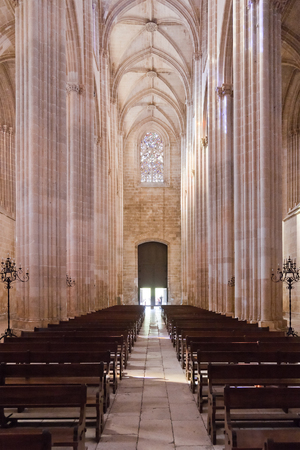 nave: Batalha, Portugal - March, 2015: Batalha Monastery. Nave, Aisles and entrance of the Church. Gothic and Manueline masterpiece. Portugal.