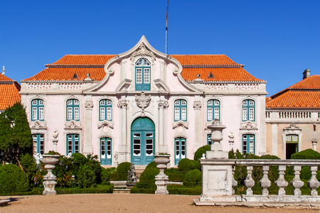 royal family: Queluz, Portugal. Neptune gardens baroque and one of the facades of the Queluz Royal Palace Portugal. Formerly used as the Summer residence by the Portuguese royal family.