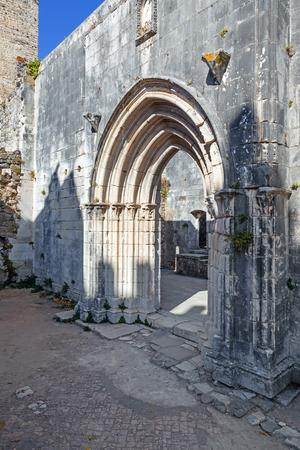 senhora: Gothic portal in the ruins of the Nossa Senhora da Pena Church aka Santa Maria da Pena inside the Leiria Castle. Leiria, Portugal. Stock Photo