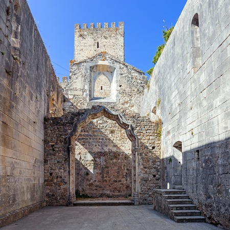 pena: The Leiria Castle Keep seen from the ruins of the Nossa Senhora da Pena Church aka Santa Maria da Pena. Leiria, Portugal. Stock Photo