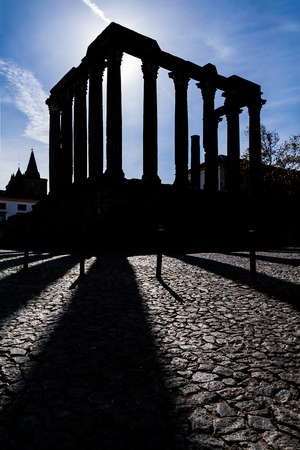 diana: Evora, Portugal. Silhouette of the iconic Roman Temple dedicated to the Emperor cult, also wrongly considered as a Goddess Diana Temple.