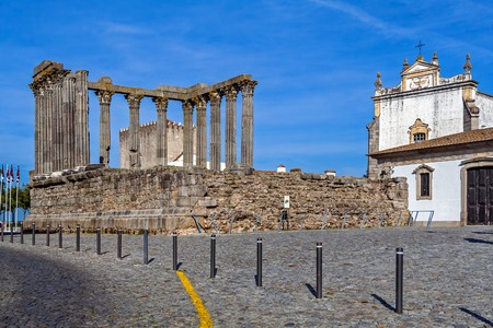 cult: Evora, Portugal. The iconic Roman Temple dedicated to the Emperor cult, wrongly considered as a Goddess Diana Temple, with the Loios Convent used as a Historical Hotel.
