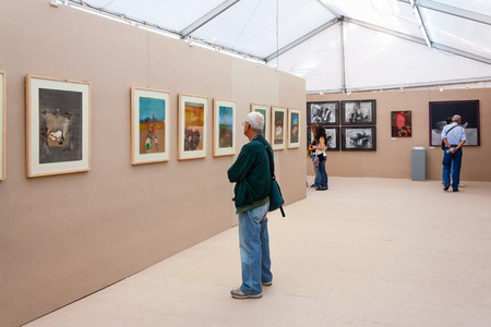 appreciating: Seixal, Portugal - September 5, 2015: Painting exhibition at the Festa do Avante Festival. Largest and most important Political-Cultural event in Portugal. Organized by the Portuguese Communist Party.