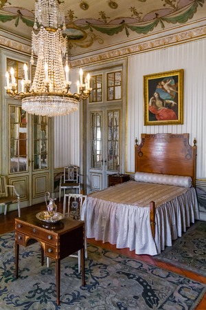 summer residence: Queluz, Portugal - September, 2015: Maria Francisca Benedita Princess bedroom in the Queluz Palace, Portugal. Formerly used as the Summer residence by the Portuguese royal family. Editorial