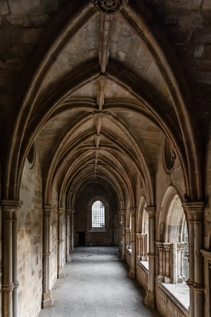 religious building: Evora, Portugal - December, 2015: Cloister of the Evora Cathedral, the largest cathedral in Portugal. Romanesque and Gothic architecture.