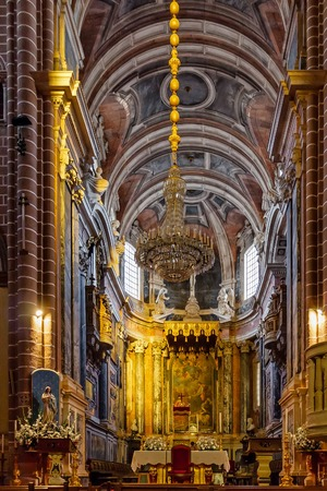 religious building: Evora, Portugal - December, 2015: The baroque altar of the Evora Cathedral, the largest cathedral in Portugal. Romanesque and Gothic architecture.