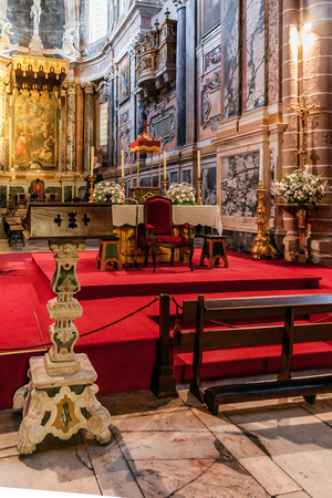 bible altar: Evora, Portugal - December, 2015: Lectern and altar of the Evora Cathedral, the largest cathedral in Portugal. Romanesque and Gothic architecture. Editorial