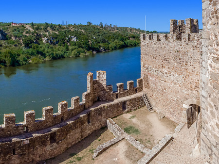 ramparts: Interior of the Templar Castle of Almourol and Tagus river. One of the most famous castles in Portugal. Built on a rocky island in the middle of Tagus river.