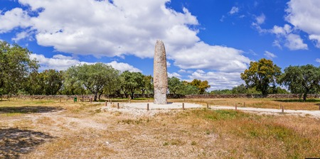 prehistory: The Standing Stone  Menhir of Meada, the largest of the Iberian Peninsula. A mysterious monument from prehistory, with a phallic shape and representing fertility. Castelo de Vide, Portugal. Stock Photo