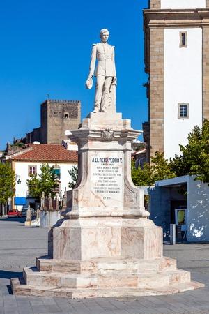 Dom Pedro V Square in Castelo de Vide. Dom Pedro V statue with Santa Maria da Devesa church in the back. Alto Alentejo, Portugal